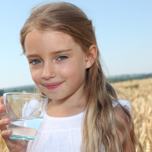 Young Girl Drinking Clean Water