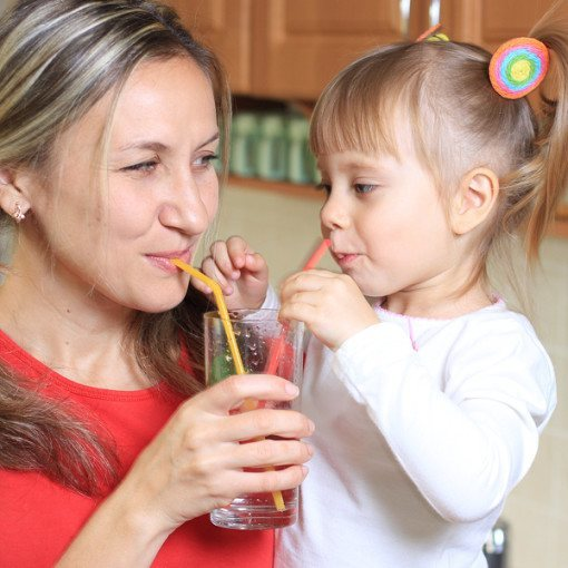 Woman and daughter Sipping water together